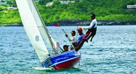 Bequia Youth Sailors put a 'double-ender' through its paces at a recent regatta on neighboring Young Island. © Graham Wiffen/grahamwiffenphotography.com