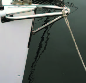 owsprits need not be huge, complicated affairs. This simple fabrication suffices to keep the A-sail away from the bow rail-and the nav lights. The latter are commonly mounted on a piece of stainless steel with not-so-dull edges.