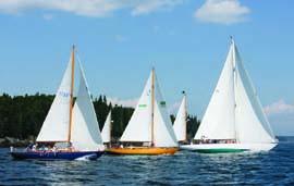 The Eggemoggin Reach Regatta fleet heads out to the start line. © Billy Black