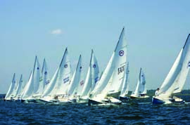 Mariners hit the line at the National Championship Regatta at Surf City Yacht Club in Surf City, NJ. The boat's racing roots include the Rhodes 18, a junior trainer designed for the Stamford Yacht Club, and the Hurricane, a popular class at Larchmont Race Week in the 1940s. © Read Howarth