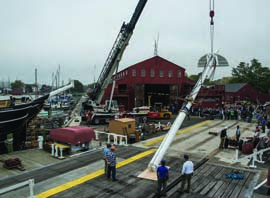 The foremast of the Charles W. Morgan is lifted up to be lowered into position on the ship at Mystic Seaport, Thursday, October 17, 2013. © Andy Price/Mystic Seaport.