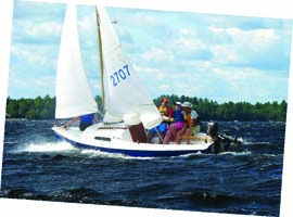 """Conceived """"when men were men and fiberglass was fiberglass,"""" the Mariner relishes a fresh breeze. Mike McCormick, family and friends enjoy a day on Sebec Lake in Maine. Photo courtesy of Mike McCormick"""