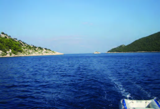 The narrow passage between Mljet (on the right) and Kobravce, with a little lighthouse just to the right of center.jpg