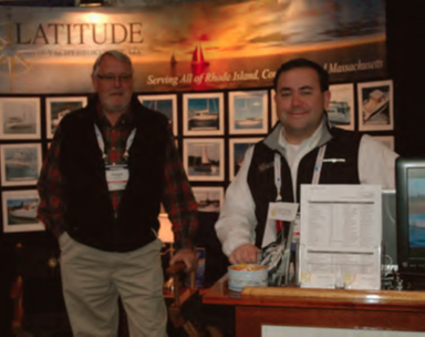 Ryan Miller (right) noted an increase in the number of serious buyers at the Providence Boat Show. On the left is Latitude Yacht Broker Tim Norton.