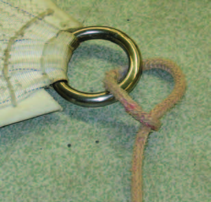 Another way to make the sheet/clew bulk smaller is to lash the sheet to the ring with multiple passes of smaller cordage.