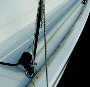 A nice detail is that the sprit stows more or less out of the way when not in use, fitting comfortably between the stanchions and securing with the same fittings it secures to the deck with.