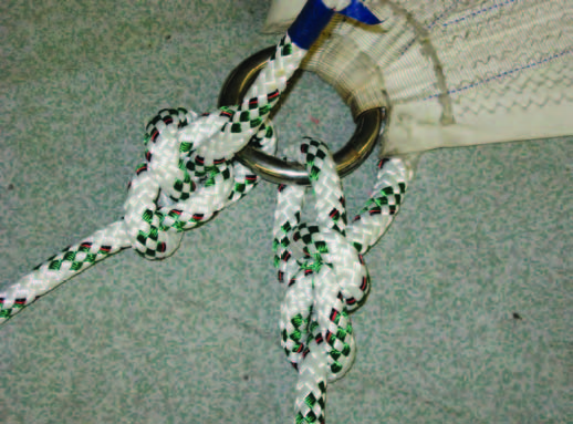Tying bowlines into the clew is fast and easy, but creates bulk that hangs up in the stay when tacking. This often makes it a long grind to get the sail in after a tack.