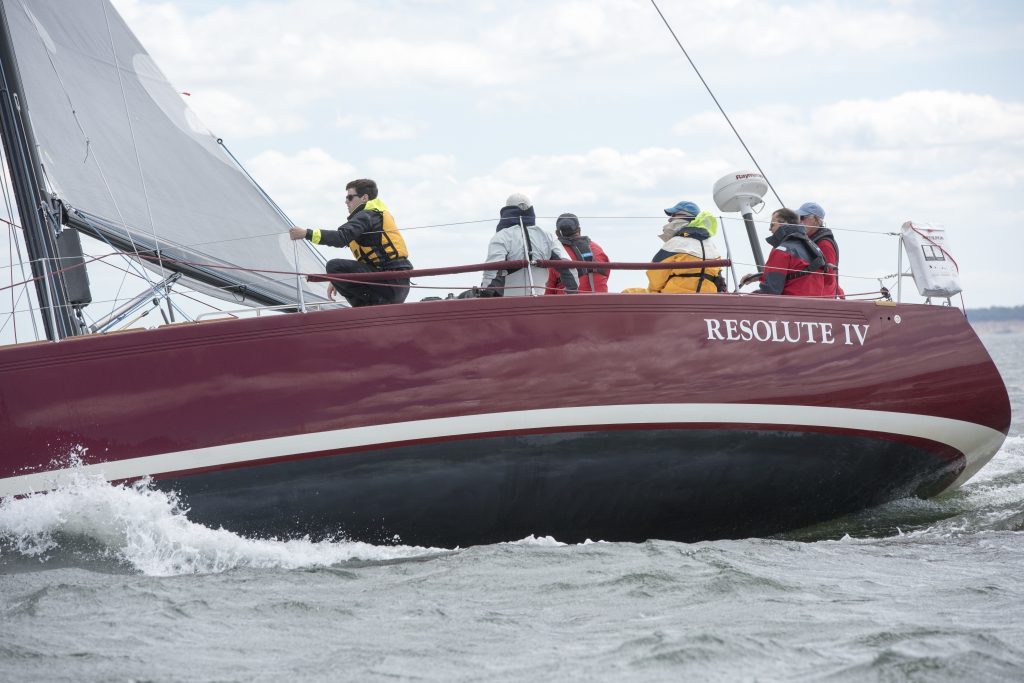 Tyler (in the yellow PFD and black jacket) enjoyed his first overnight race aboard Terrence Arndt's IMX-40 Resolute IV (St. Louis, MO). © Allen Clark/PhotoBoat.com
