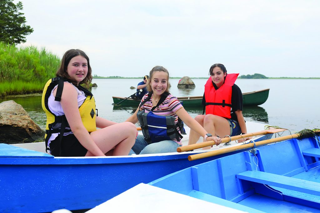These young ladies were among the 13 high school students that constructed these two dories in CCRI's inaugural Summer Youth Boatbuilding Program. © CCRI Marketing