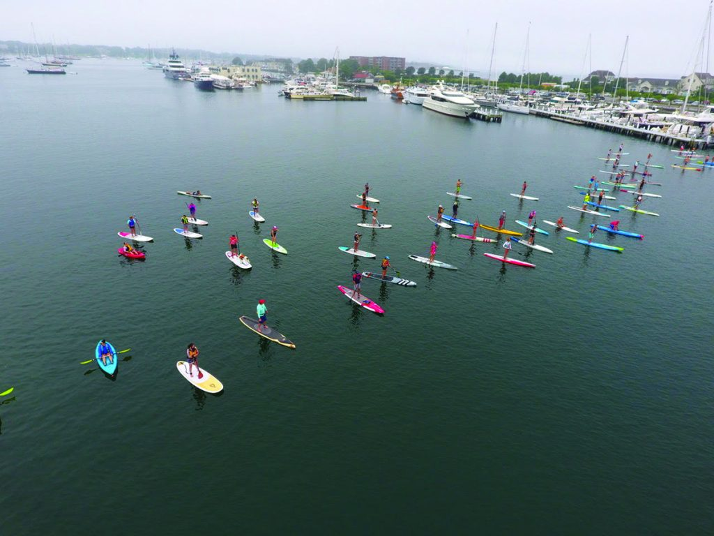 Paddle for Access racers line up for the start by Safe Harbor Newport Shipyard. © cleanocaenaccess.org